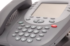 Modern office system phone with large LCD screen.